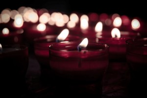 red lit candles in darkness